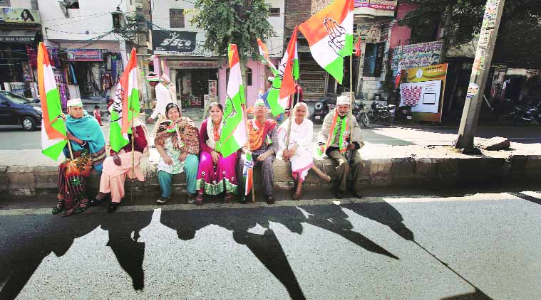 Supporters wait for Congress vice-president Rahul Gandhi's road show at Sultanpur Majra. (Source: Express Photo by Ravi Kanojia)