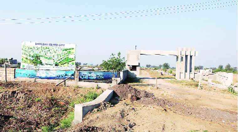 Hoardings of private developers hard-selling Dholera Special Investment Region as India's first smart city. (Express Photo by: Javed Raja)