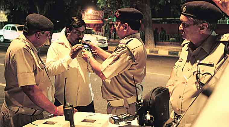 Drunk driving, alcometer, alcohol driving, assaulting police, drink and drive, road accidents, tearing uniform, india news, indian express news, latest news, crime news