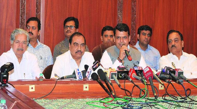 Fadnavis with Cabinet colleagues at a press conference on Saturday. (Source: Express photo)