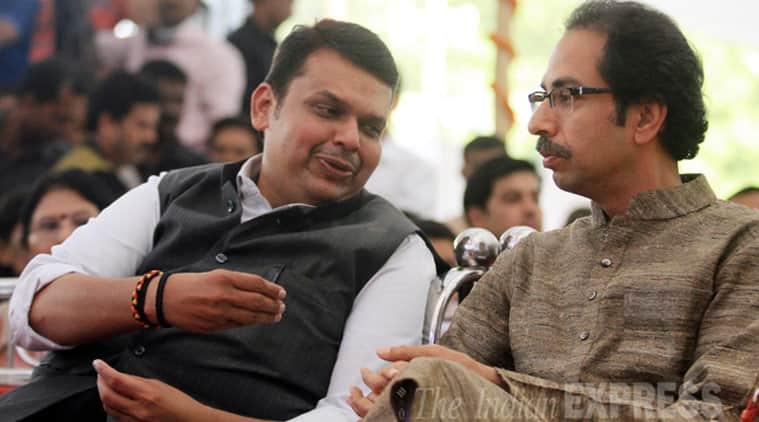 Maharashtra CM Devendra Fadnavis and Uddhav Thackray  at the swearing-in ceremony held at Vidhan Bhavan.(Source: Express phoot by Pradeep Kochrekar)