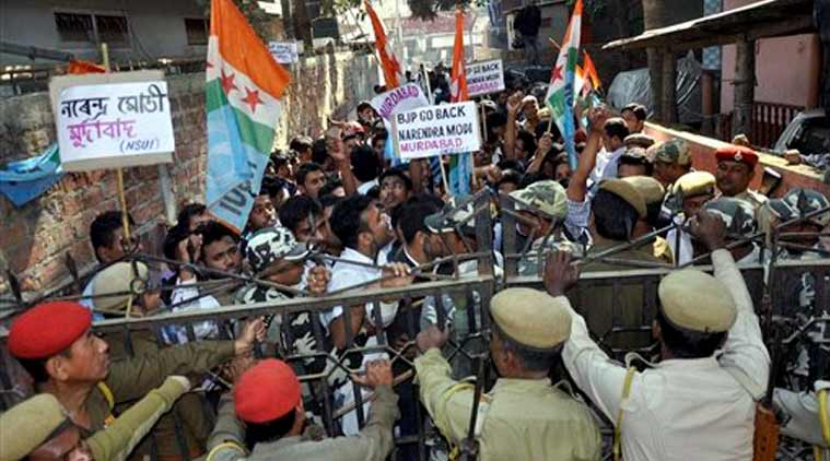 "Police personnel trying to stop the activists of National Students' Union of India (NSUI) who were staging a demonstration in front of the BJP state party head office in Guwahati on Wednesday against BJP's vision document for the Delhi assembly polls. The BJP's vision document referred people from north eastern states as ""immigrants"". (Source: PTI)"