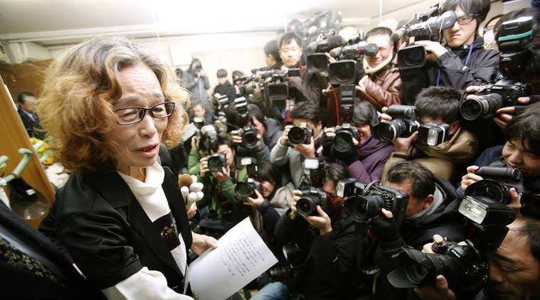 Junko Ishido, left, mother of Japanese journalist Kenji Goto, speaks during a press conference at her home in Tokyo, Sunday, Feb. 1, 2015 after the release of an online video that purported to show an Islamic State group militant beheading her son. Japan condemned with outrage and horror on Sunday the video posted on militant websites late Saturday Middle East time. (AP Photo/Shizuo Kambayashi)