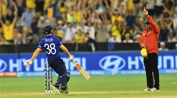 England's James Taylor stops running as Umpire Aleem Dar gives out England's James Anderson during their Cricket World Cup pool A match against Australia Melbourne in Melbourne, Australia, Saturday, Feb. 14, 2015.(AP Photo)