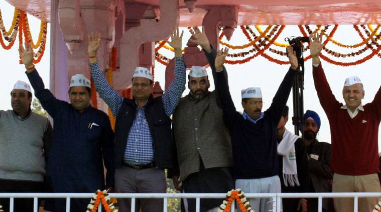 Arvind Kejriwal with Manish Sisodia with others Cabinet ministers after taking oath at Ramlila Maidan in New Delhi  on Saturday. (Source: Express photo by Prem Nath Pandey)