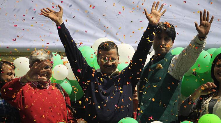 Arvind Kejriwal celebrates winning of AAP Party with his wife and AAP leaders at Patel Nagar office in New Delhi on Tuesday. (Source: Express photo by Praveen Khanna)
