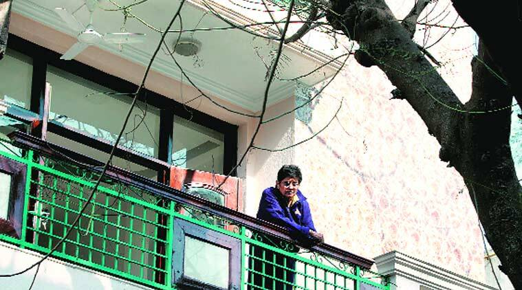 Kiran Bedi (at her residence) spend some time on the eve of counting in quiet reflection. (Source: Express Photo by Renuka Puri)