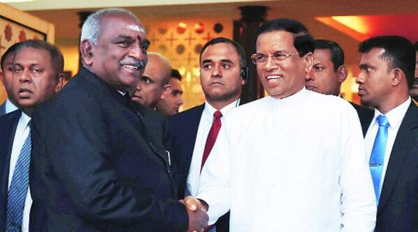 Maithripala Sirisena being welcomed by MoS for shipping P Radhakrishnan in New Delhi on Sunday.