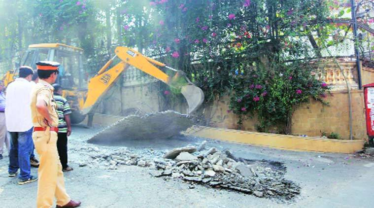 Police and BMC officials inspect the demolition of a ramp outside Shah Rukh Khan's bungalow in Bandra on Saturday.  (Source: Express Photo by Ganesh Shirsekar)