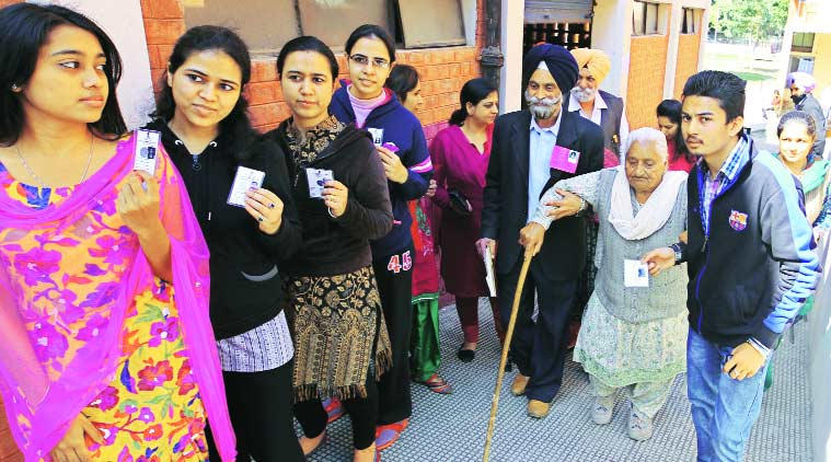During the polling which started at 8 am across 50 wards and in 118 polling booths in Mohali on Sunday. (Source: Express Photo by Jasbir Malhi)