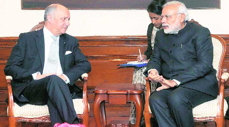 Prime Minister Narendra Modi with French Foreign Affairs and International Development Minister Laurent Fabius in New Delhi on Thursday. (Source: PTI)