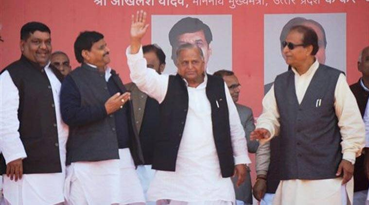 SP President Mulayam Singh Yadav waves at function to launch foundation stone of a sugar mill in Azamgarh on Friday. Also seen in the picture are UP Ministers Azam Khan and Shivpal Singh Yadav. (Source: PTI)
