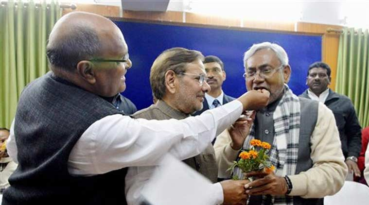 D(U) national president Sharad Yadav and a party leader greeting Nitish Kumar after he was elected new leader of JD(U) Legislature Party in Bihar Assembly, in Patna on Saturday. ( Source: PTI)