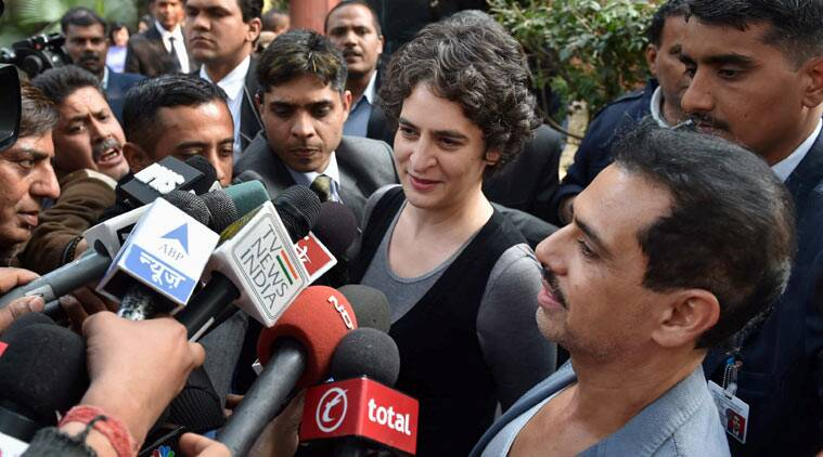 Priyanka Vadra with husband Robert Vadra address media after casting their votes for Assembly elections in New Delhi on Saturday. (Source: PTI )