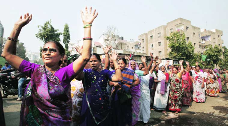 A group of women take out a rally against biometric system in ration cards in Ahmedabad. (Source: Express Photo by Javed Raja)