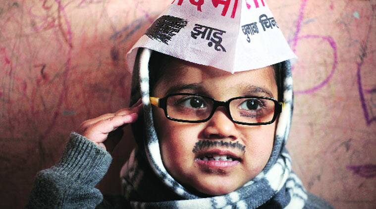 Three-year-old Rudra Pratap Singh dressed up as AAP Chief Arvind Kejriwal.  (Source; Express Photo by Oinam Anand)