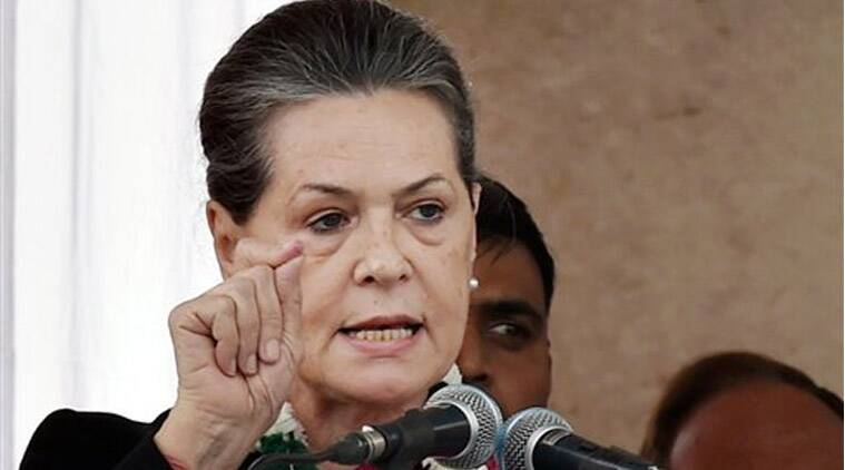 Congress President Sonia Gandhi addresses the crowd during an election campaign rally at Badarpur in New Delhi on Sunday. (Source: PTI)