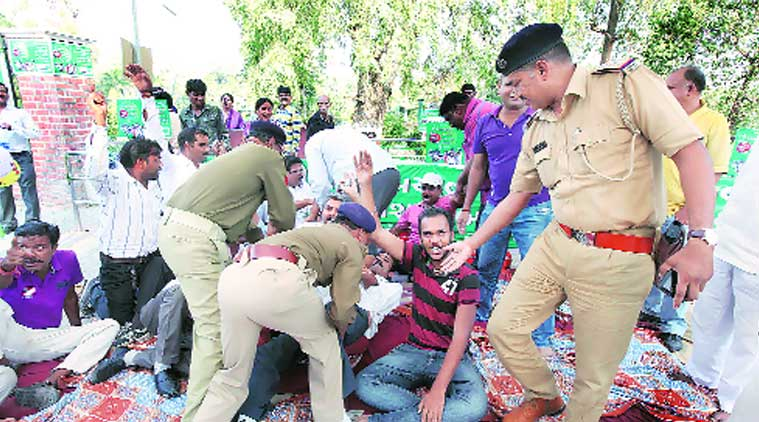 Police evict people sitting on a hunger strike against the Butterfly Park in Kamatibaug, in Vadodara on Sunday. (Source: Express Photo by Bhupendra Rana)