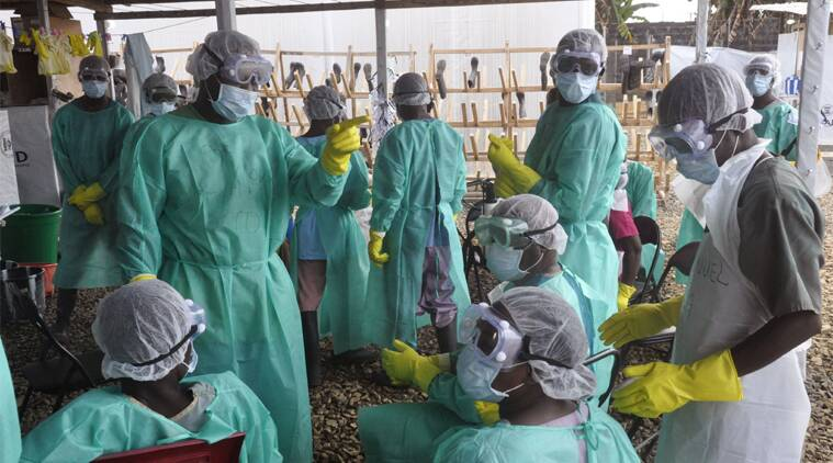 Health care workers inside a USAID, funded Ebola clinic with their Ebola virus protective gear in Monrovia, Liberia, Friday, Jan. 30, 2015. (AP Photo)