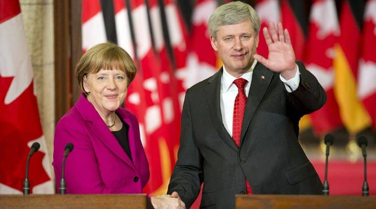 Canadian Prime Minister Stephen Harper with German Chancellor Angela Merkel following a joint news conference on Parliament Hill in Ottawa, Ontario on Monday, Feb. 9, 2015. (Source: AP)