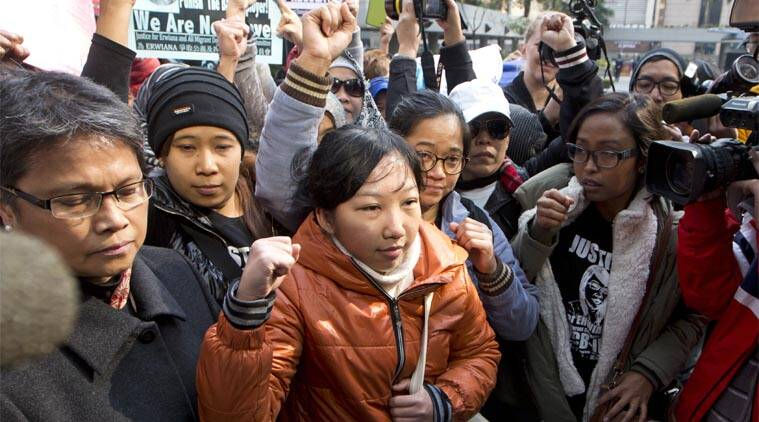 Indonesian maid Erwiana Sulistyaningsih, front center, poses with her supporters as she arrives at a court in Hong Kong, Tuesday, Feb. 10, 2015. (Source: AP)