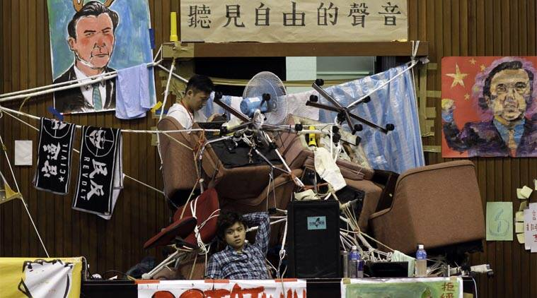 FILE - In this March 28, 2014 file photo, student protesters against a pro-China trade pact continue to occupy the legislature floor in Taipei, Taiwan.  (AP Photo)