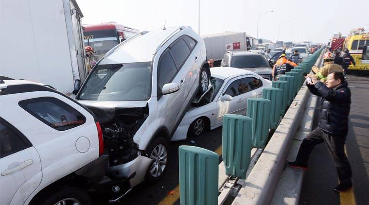 South korea, south korea car pile up, car accident, cars smash on bridge, Incheon International Airport, korean airport bridge jam, car pile up, World Newsvehicles sit on Yeongjong Bridge in Incheon, South Korea, Wednesday, Feb. 11, 2015.