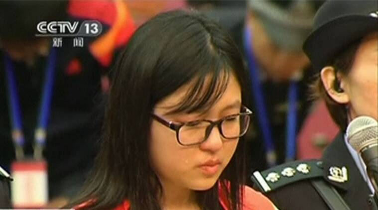 Defendant Zhang Hang cries during her trial for the murder of a woman at a McDonald's restaurant, in Yantai City, Shandong province October 11, 2014 in this still image taken from video. (REUTERS/CCTV)