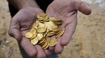 Israel unveils its largest find of medieval goldcoins