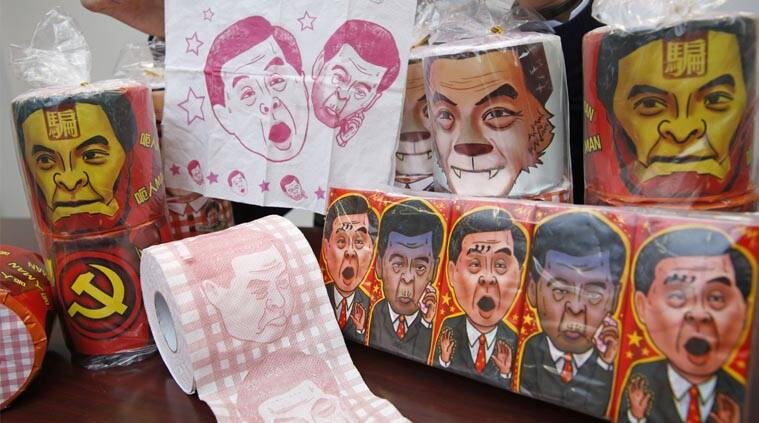 Rolls of toilet paper and packages of tissue paper printed with images of pro-Beijing Hong Kong Chief Executive Leung Chun-ying. (AP Photo)