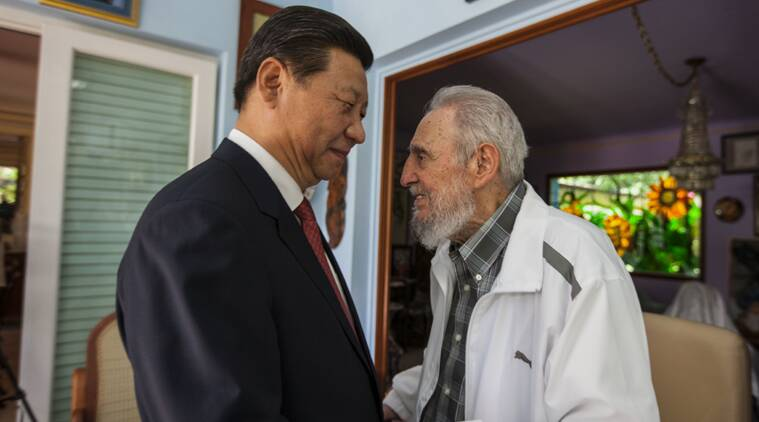 FILE - In this July 22, 2014 file photo, Cuba's Fidel Castro, right, greets China's President Xi Jinping in Havana, Cuba. in Havana, Cuba. (AP Photo)