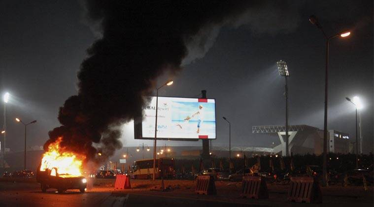 A pickup truck bursts into flames as a riot breaks out outside of a soccer match between Egyptian Premier League clubs Zamalek and ENPPI at Air Defense Stadium in a suburb east of Cairo, Egypt, Sunday, Feb. 8, 2015. (AP Photo)