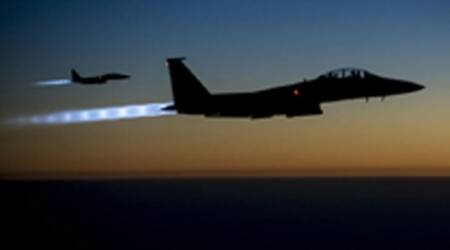 US-led strikes on IS after group seizes 220 Christians