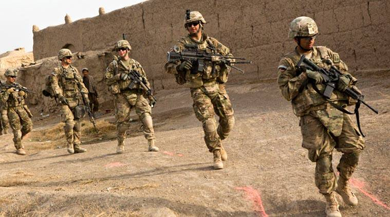 Soldiers from the U.S. Army's Bravo Company, 1st Battalion, 36th Infantry Regiment go on patrol near Command Outpost AJK (short for Azim-Jan-Kariz, a near-by village) in Maiwand District, Kandahar Province, Afghanistan. (Source: Reuters)