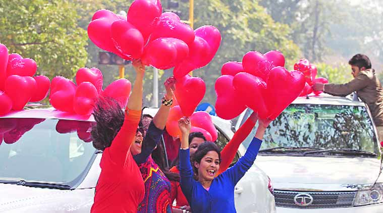 Youngsters celebrate Valentine's Day in Sector 10, Chandigarh, on Saturday. (Source: Express Photo by Kamleshwar Singh)