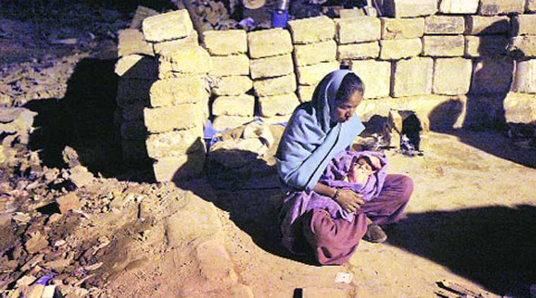 A homeless woman with her month-old baby at Rangpuri Pahadi slums.