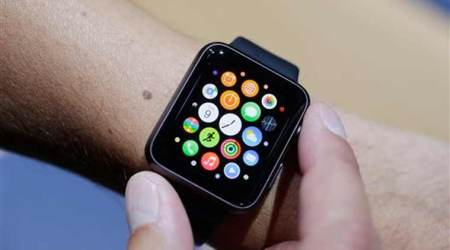 In file photo, the new Apple Watch is modeled during a media event in Cupertino, Calif.