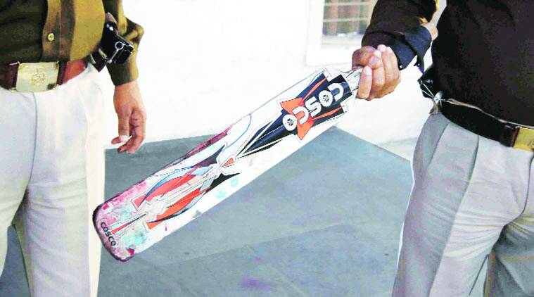 Cricket bat recovered from the couple's flat in Gaur Village, Ghaziabad. photos: (Source: Express photo by Gajendra Yadav)