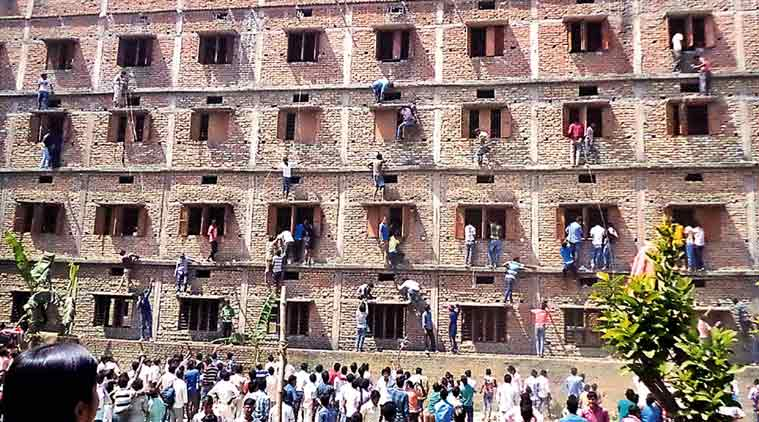 The scene of cheating at Vidya Niketan in Mahnaar in Vaihali during the 10th Board exam during the 18 and 19 march. Two company of police (200 jawans ) deployed in this area to conduct fair examination. (Source: Express Photo By Prashant Ravi)