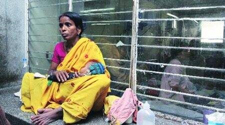 A woman waiting with her child outside Deen Dayal Upadhyay Hospital, New Delhi.