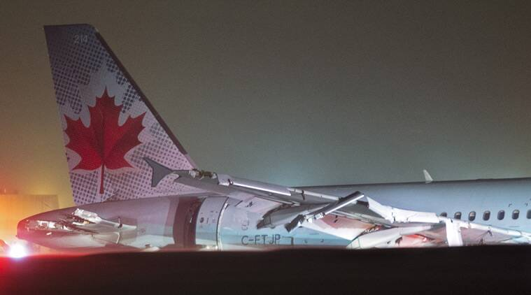 Air Canada flight 624 rests off the runway after landing at Stanfield International Airport in Halifax, Canada on Sunday, March. 29, 2015. Air Canada says at least 22 people were taken to hospital. The flight had 132 passengers and five crew members. (AP Photo/The Canadian Press, Andrew Vaughan)