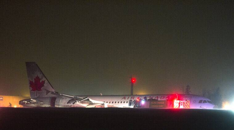 Air Canada says at least 22 people were taken to hospital. The flight had 132 passengers and five crew members. (AP Photo/The Canadian Press, Andrew Vaughan)