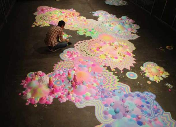 Welcome to the candyland! Floor art made with candy, sugar, beads and toys