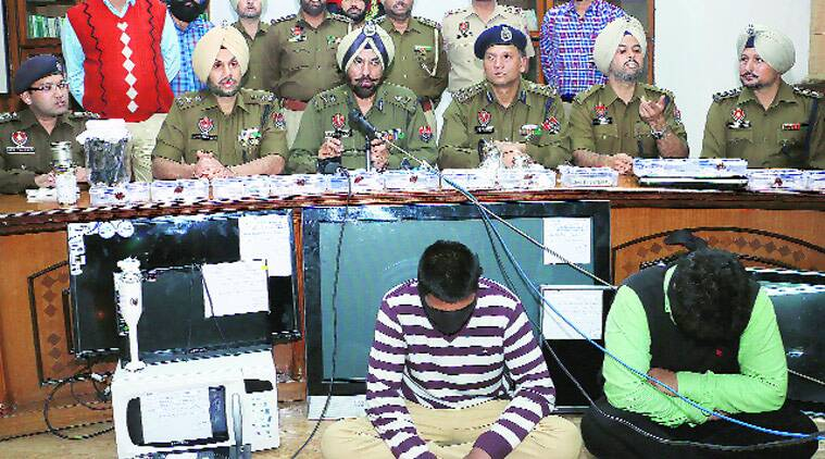 Mohali police during a press conference after the arrest in the Rajat Jewellers dacoity case. )Source: Express Archive photo)