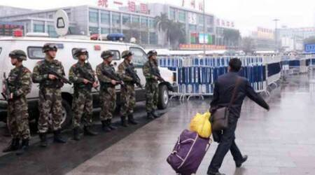 China knife attack: Nine injured, police shoot suspect dead