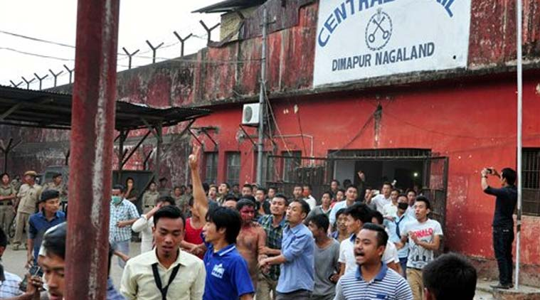 In this Thursday, March 5, 2015 photo, members of a mob pull a man, centre with blooded face, accused of rape, out of the Central Jail where he was held in Dimapur, in the northeastern Indian state of Nagaland. Several thousand people overpowered security at Dimapur Central Prison in Nagaland on Thursday, and seized the rape suspect, whom they also accused of being an illegal migrant from Bangladesh. They pelted him with stones and beat him to death, said police Constable Sunep Aier. (Source: AP)