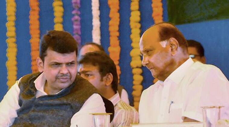 Maharashtra Chief Minister Devendra Fadnavis and NCP chief Sharad Pawar at the award presentation ceremony during the Annual General Meeting (AGM) of the Vasantdada Sugar Institute (VSI) at Manjri in Pune on Saturday. (Source: PTI)