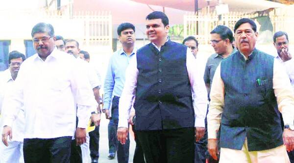 Devendra Fadnavis and other MLAs enter Vidhan Bhavan on the first day of the session on Monday. (Express photo by Ganesh Shirsekar)