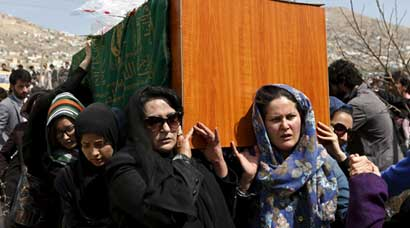 Afghan women's rights activists break with tradition, carry coffin of woman beaten to death