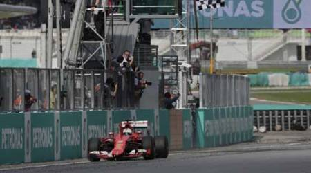 Formula One: Sebastian Vettel, Ferrari end drought in rain